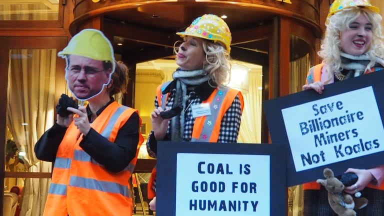 Australian anit-coal protesters stand outside the Hotel California in Paris.