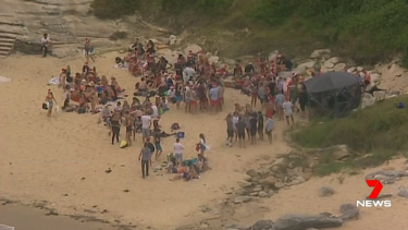 Police broke up a large beach party in Little Bay on Christmas Day.