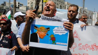 A Palestinian activist during a protest against the visit of US delegation to the West Bank city of Ramallah on Thursday.