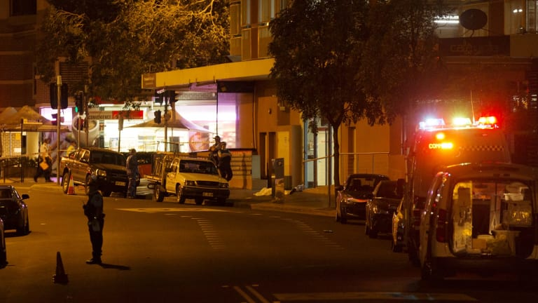 The scene of the shooting on Friday, where witnesses saw two bodies lying on the ground.