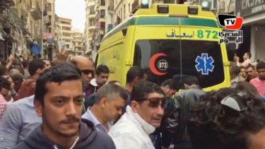 An ambulance outside Saint Mark's Cathedral following a suicide bombing that killed several people, just after Coptic Pope Tawadros II finished services in the city of Alexandria.
