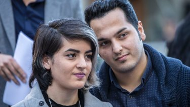 Mojgan Shamsalipoor and her husband, Milad Jafari, at the World Refugee Day protest.