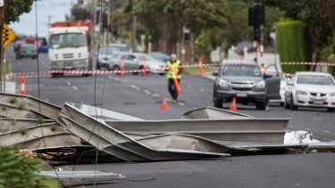 The roof of a house blew onto Pascoe Vale Road in Essendon, bringing down power lines.