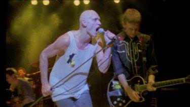 Peter Garrett seen on stage in the documentary <i>Midnight Oil 1984</I>.