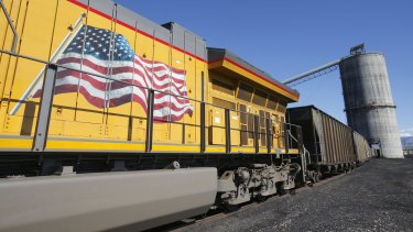 An American flag is displayed on Union Pacific Corp. train as it is loaded with coal at the Savage Industries Co. processing facility in Price, Utah, on Friday, May 27, 2016. Power-plant demand for gas has been breaking seasonal records amid low prices and a record shutdown of coal plants last year to meet stricter environmental regulations, government data show. Photographer: George Frey/Bloomberg