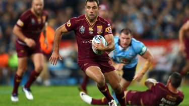Nothing between them: Cameron Smith finds some open space during Origin I on Wednesday night.