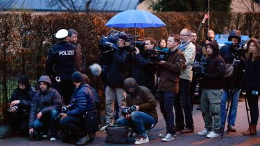 Media gather in front of the house believed to belong to the parents of Andreas Lubitz on Thursday.