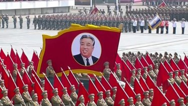A portrait of the country's founder Kim Il-sung is carried during a parade in Pyongyang on Saturday.