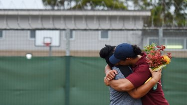 Overjoyed with his HSC results, Leo hugs a family member after the presentation day at Girrakool School at Frank Baxter Juvenile Justice Centre on the Central Coast.