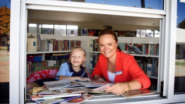 St Joseph's Primary reading recovery teacher Narelle Cartwright with a pupil.