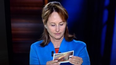 French Environment Minister Segolene Royal reading the Environment Victoria postcard calling for Hazelwood to be shut.