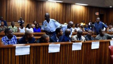 Former policemen, left to right, Meshack Malele, Thamsanqa Ngema, Percy Mnisi, Bongamusa Mdluli, Sipho Ngobeni, Lungisa Gwababa, Bongani Kolisi and Linda Sololo.