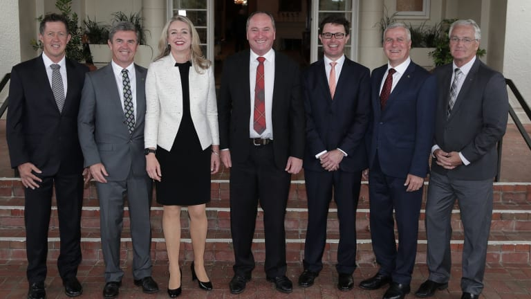 Nationals MPs in the ministry pose with leader Barnaby Joyce (centre) after Wednesday's swearing-in ceremony at Government House.