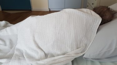 The grandmother after her hospital visit. She refused to get out of bed. A month later, it is still difficult to convince her to get up in the morning.