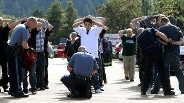 Police search students outside Umpqua Community College in Roseburg, Oregon.