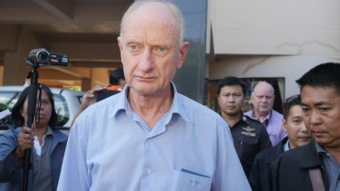 Peter Dundas Walbran with police after his arrest in Ubon Ratchathani, Thailand on December 9.