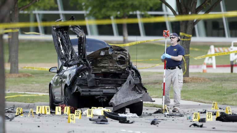 FBI crime scene investigators document evidence outside the Curtis Culwell Centre in Garland, Texas.