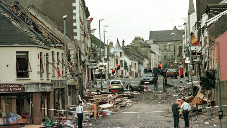 Royal Ulster Constabulary Police officers at the scene of a car bombing in the centre of Omagh, 115km west of Belfast, Northern Ireland, in 1998.
