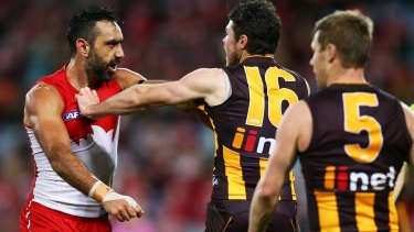 Rough night: Sydney's Adam Goodes challenges Isaac Smith of the Hawks at ANZ Stadium on Saturday night.