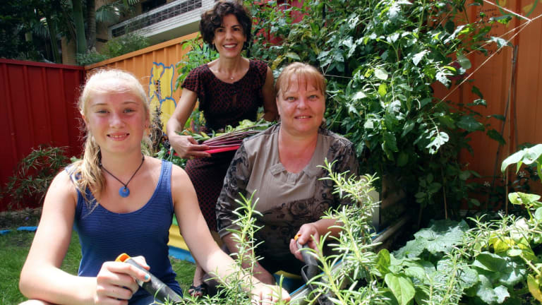 Nazha Saad (centre), CEO of St George Community Housing, at a permaculture garden created by St George Community Housing for residents.