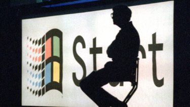 Bill Gates sits on stage during a portion of the Windows '95 launch  event in 1995.