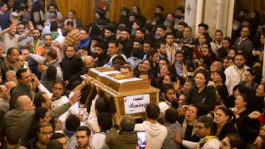 Relatives of Coptic Christians grieve as they carry the coffin of Nermin Sadek, one of the victims of the militants attack on Mar Mina church.