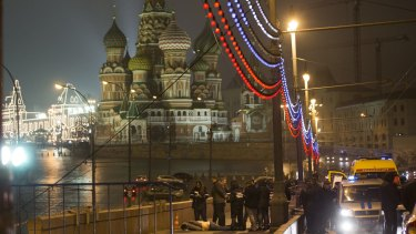 Russian police investigate the the body of Boris Nemtsov, a former Russian deputy prime minister and opposition leader at Red Square with St Basil Cathedral in the background in Moscow, Russia.