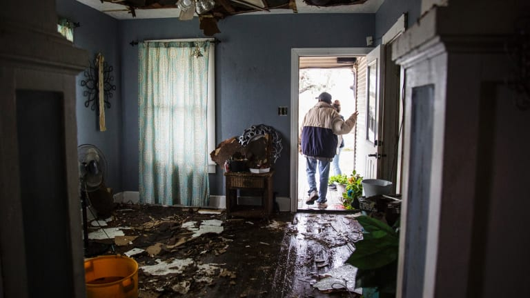 Lucas Garcia walks out of his home in Refugio, Texas. His family rode out Hurricane Harvey in a single room in their home.