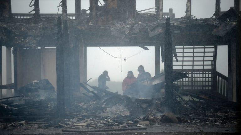 A beach house in Bolivar, Texas that caught fire during Hurricane Harvey.