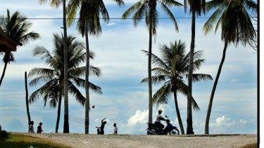 Asylum seekers get a recreation break away from the camp on Nauru.