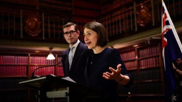 NSW premier Gladys Berejiklian and tresaurer Dominic Perrottet have agreed a deal to sell the state's land titles unit.