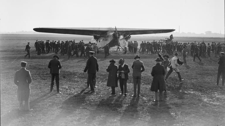Crowds greet the Southern Cross on its arrival in Brisbane on 9 June 1928.