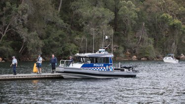 A police boat attends the scene of the crash.