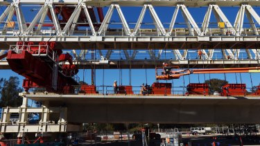 A Skytrain span being assembled by one of two massive movable gantries.