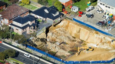 An aerial view of the townhouses and the excavation.