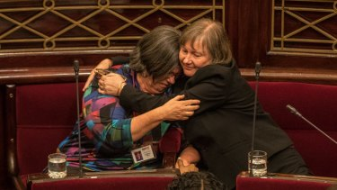 Greens MP's Colleen Hartland and Samantha Dunn embrace after the voluntary assisted dying laws pass the upper house.