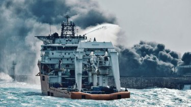 A firefighting boat works to put on a blaze on the oil tanker Sanchi in the East China Sea off the eastern coast of China on January 10, 2018.