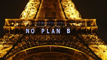 """""""NO PLAN B"""" is projected on the Eiffel Tower as part of the Climate Change Conference in Paris, 2015."""