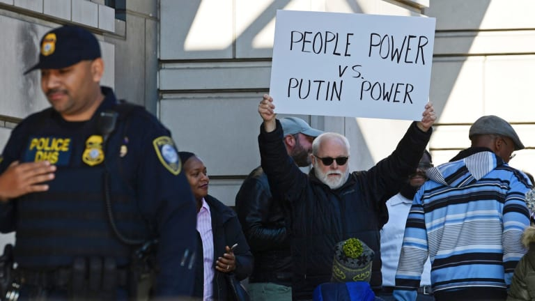 A protestor stands outside the court in Washington.