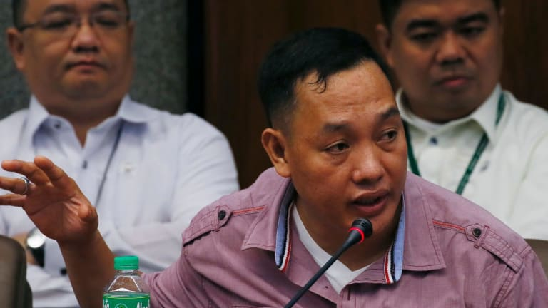 Philippine police officer Ricky Santa Isabel, who was allegedly involved in the kidnapping and subsequent killing of South Korean businessman Jee Ick-joo, testifies at the Senate probe.