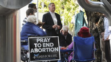 The Catholic Archbishop of Canberra and Goulburn, Christopher Prowse, joined a prayer vigil outside the Moore Street abortion clinic last year.