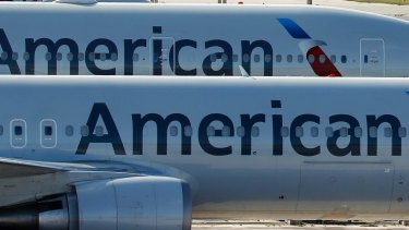 A pair of American Airlines jets in Miami.