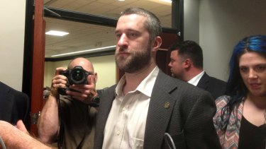 Television actor Dustin Diamond exits the courtroom on Friday night after a 12-person jury convicted him of two misdemeanours stemming from a barroom fight.