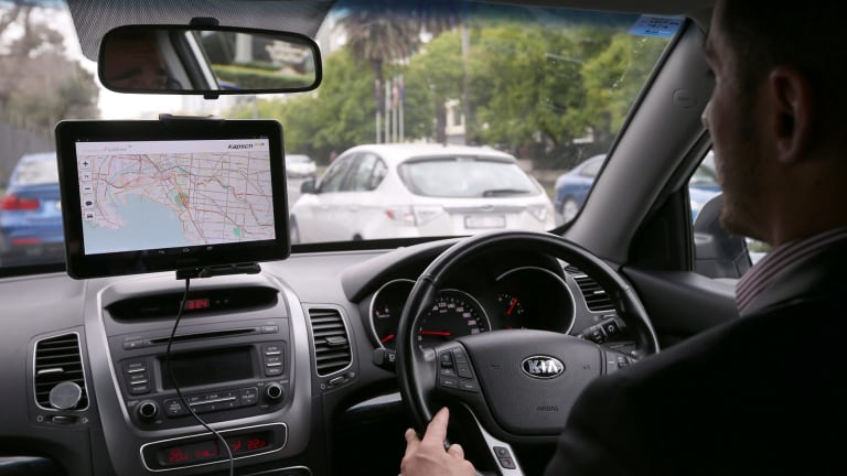 The tablet inside a connected vehicle gives the driver information about local traffic conditions.
