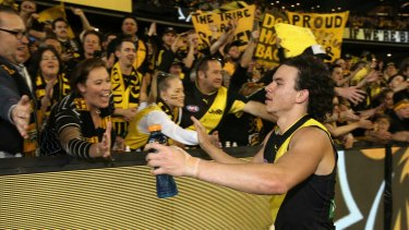Going to the big dance: Daniel Rioli celebrates with Tiger fans after the preliminary final win.