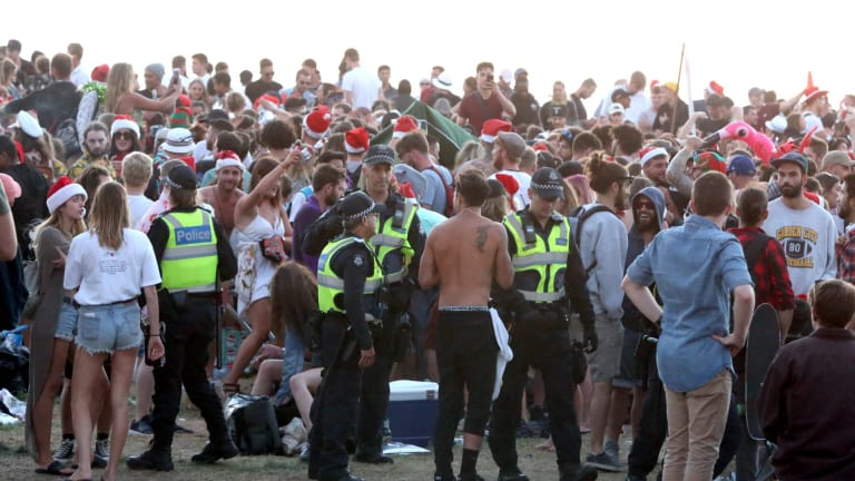 Thousands gathered at St Kilda beach,drinking heavily.