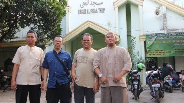 Islamic State supporter Budi Waluyo (right) with three former Jemaah Islamiah members in front of the al-Fataa mosque in Jakarta.