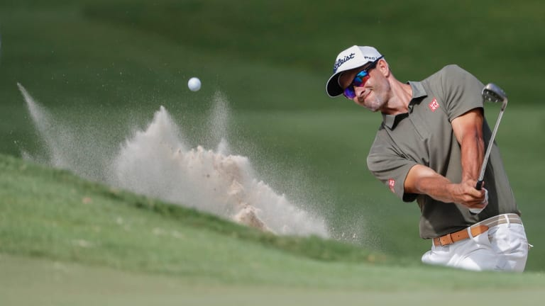 Trouble: Adam Scott hits out of the bunker on day two of the Australian PGA Championships at Royal Pines.