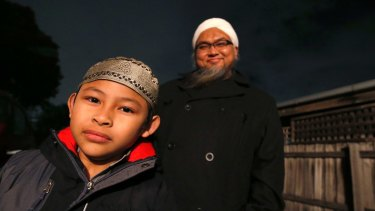 Abdullah Utmo and his son, Ahmad, seven.