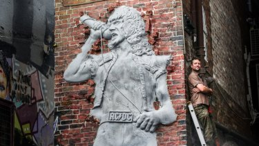 Bon Scott was honoured with a permanent sculpture coming out of the Cherry Bar brick wall.